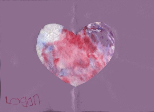 """Logan's Beautiful Heart""  It's purple construction paper with a heart-shaped cut-out.  A dyed coffee filter is glued to the back of the construction paper so that it shows through the heart shape."