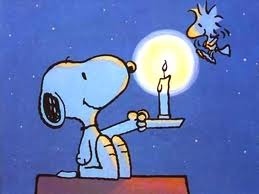 Snoopy lights a candle