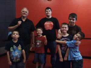 Dad and me and my 5 brothers are getting ready to go in the 4D theater.  Mom came, too, but she was taking the picture.